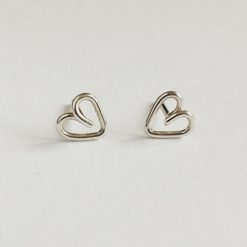 https://www.etsy.com/listing/176748747/sterling-silver-small-heart-studs-post?ref=shop_home_active_24