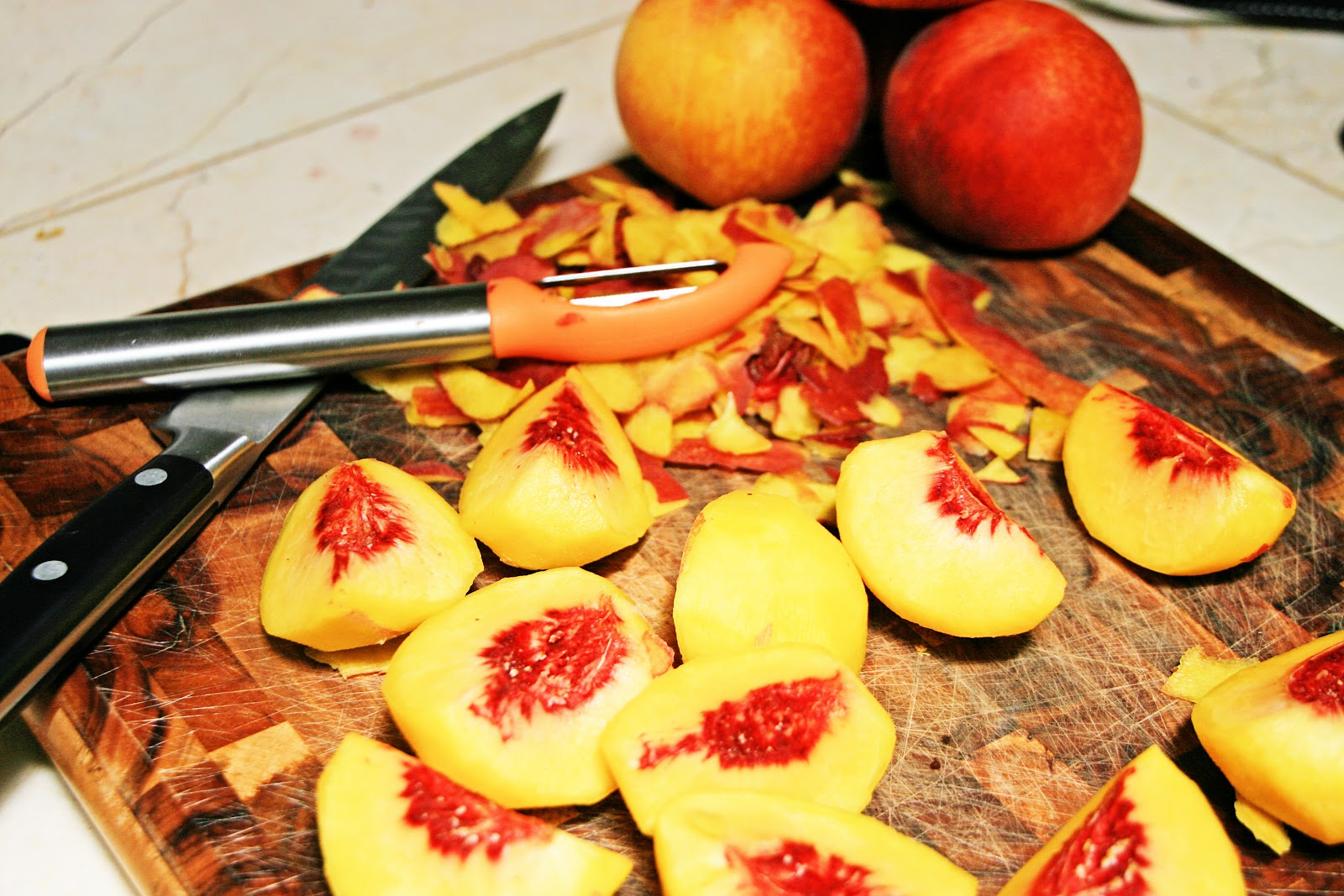 Remove the pits from the peaches, peel, chop and puree in a food ...