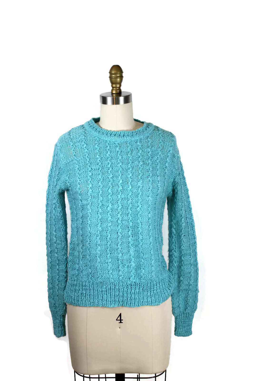 https://www.etsy.com/listing/208961726/1970s-teal-bloucle-sweater-70s-cable