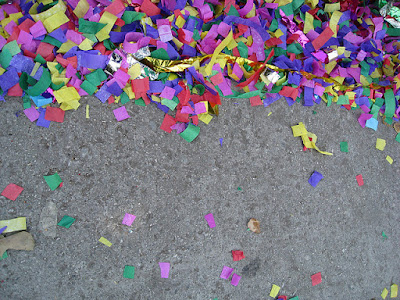 confetti on street by Shearrei Thai