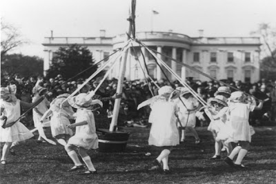 Historical photo of children with maypole at White House Easter Egg Roll