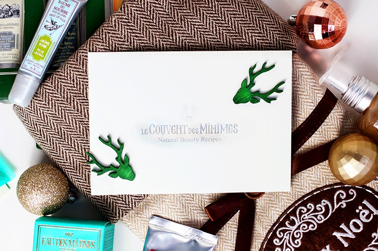 A beauty blogger holds A Le Couvent Des Minimes Christmas Stocking Giveaway