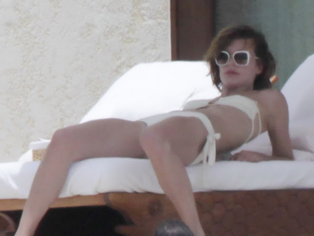 Milla Jovovich Hot Topless and Bikini in Los Cabos