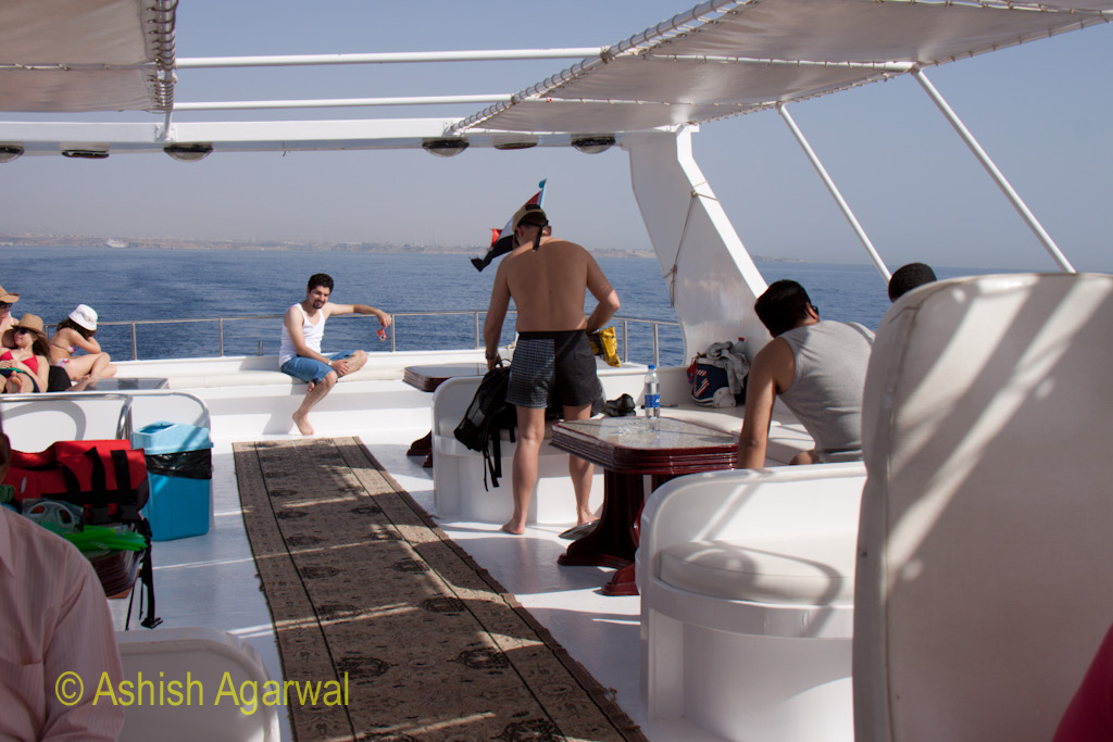Tourists on the yacht that takes people to the snorkeling location in the Red Sea in Egypt