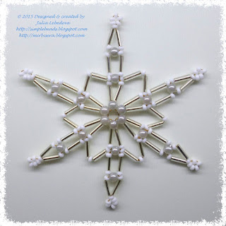 Beaded snowflake out of different types of beads