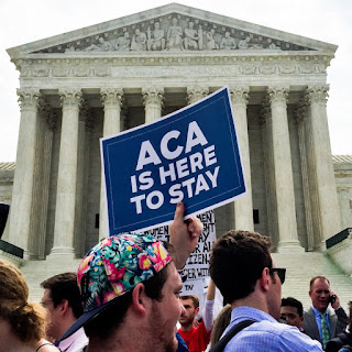 image of Protesters in favor of the ACA at the Supreme Court