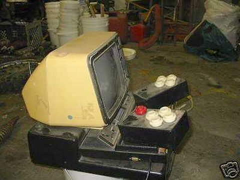 Circa 1982 Ken Yankelevitz adapted Atari VCS 2600 games console for improved accessibility. Discarded in a dusty looking garage along with old black and white portable monitor and stand.