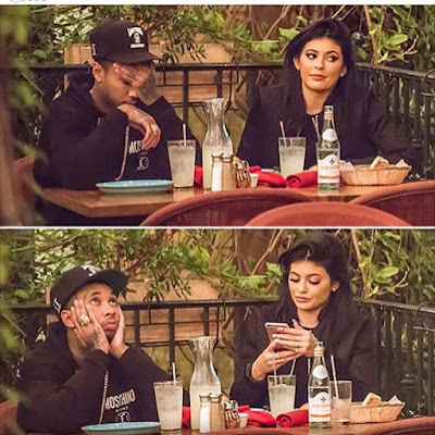 Tyga makes funny facial expressions while out with Kylie Jenner.
