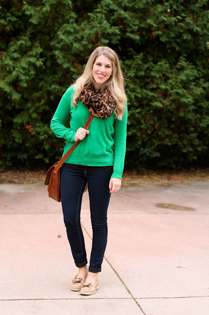 green sweater with leopard scarf, dark skinny jeans and sperrys