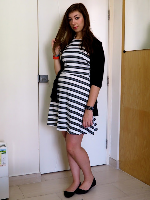Simple Stripes | outfit of black & white striped skater dress with a black cardgian and black flat shoes for work