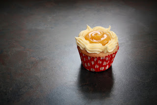 Vanilla cupcakes with passion fruit curd and passion fruit buttercream