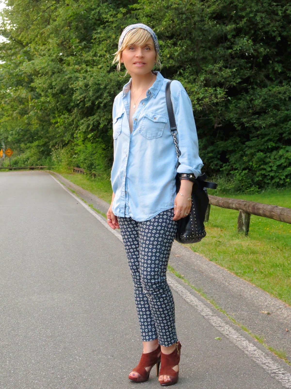 styling printed pants with a chambray shirt and patterned beanie