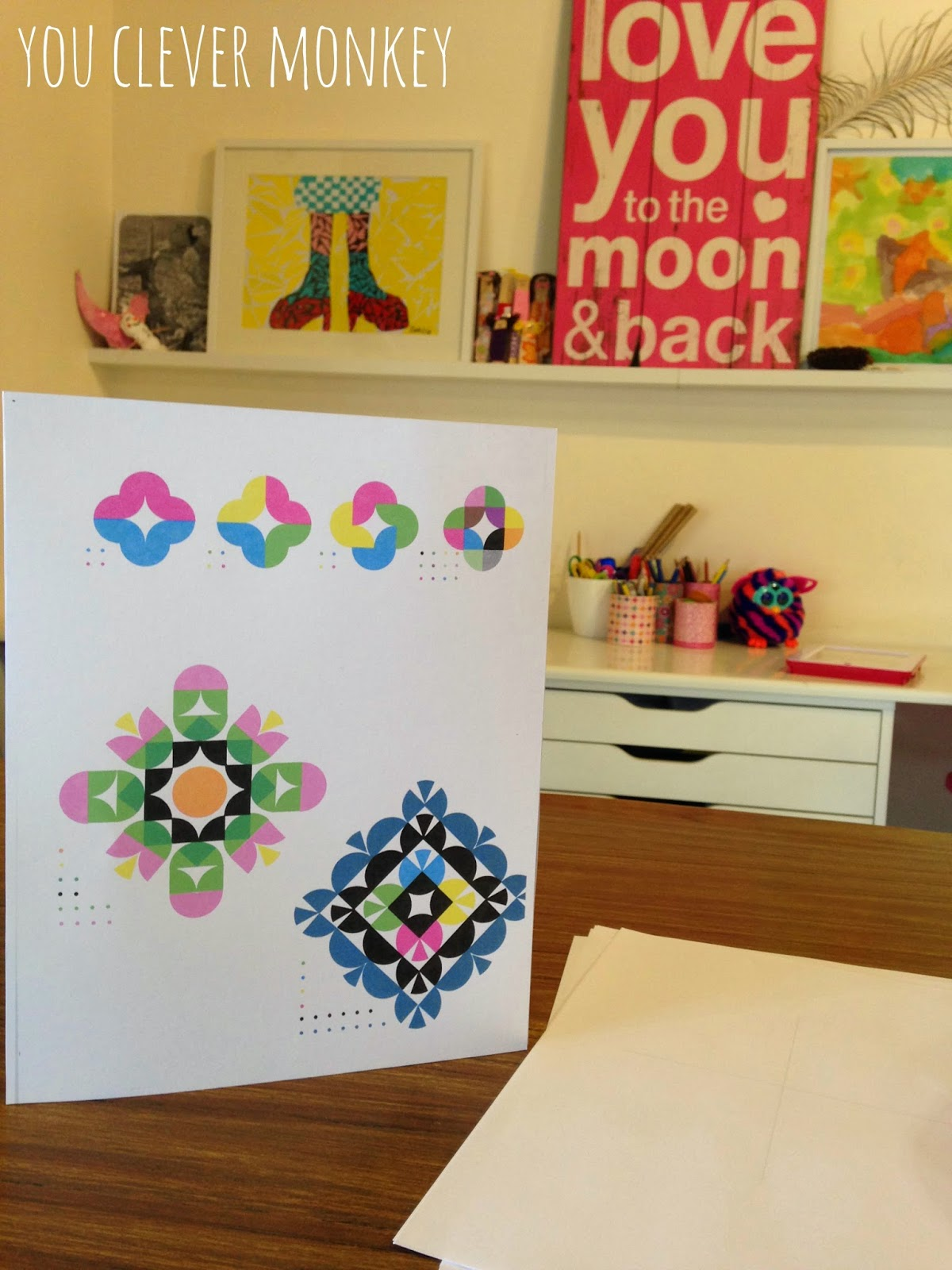 Symmetrical sticker pictures - simple art activity inspired by Ed Emberley's Picture Pie book.  Perfect for mixed ages.  Go to http://youclevermonkey.com/ for more information.