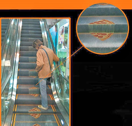 Pizza Kingdom ads on escalators