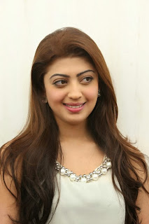 Actress Pranitha Pictures in White Dress at Homeo Trend Super Speciality Hospital Launch 0008