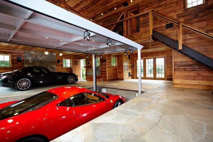 The most amazing garage ever damn cool pictures for Cool car garage ideas