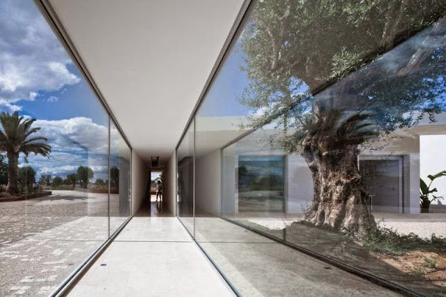 large glass windows design Modern House with Pool in Tavira