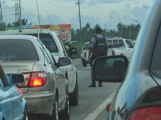 """""""Directing Traffic in bulletproof vests""""; photo by Taran Rampersad, used under a  CC BY-NC-ND 2.0 license"""