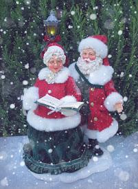 Mr and Mrs Santa Claus caroling (Possible Dreams)