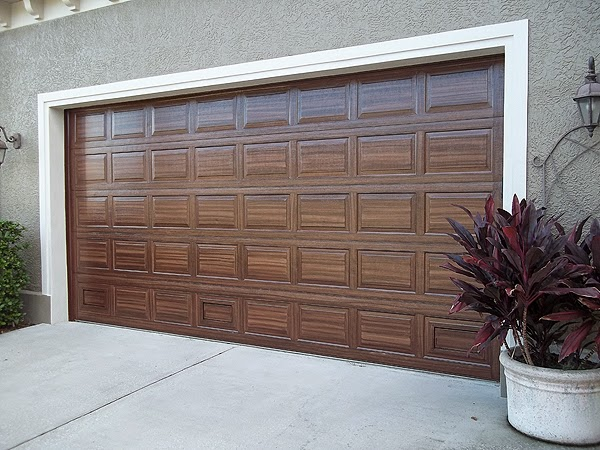 Finished painting over sized two car garage door for Paint garage door to look like wood