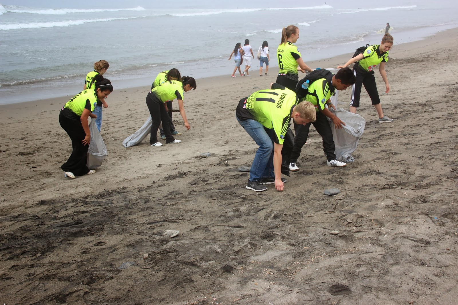 People Cleaning The Beach Cleaning Huanchaco Beach