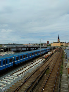 A train passing along the bridge in Stockholm.