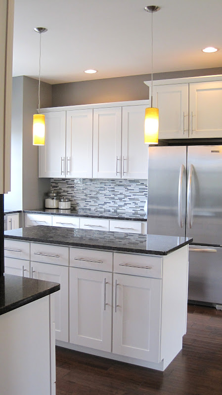 the kitchen cabinets are a shaker style cabinet from aristokraft