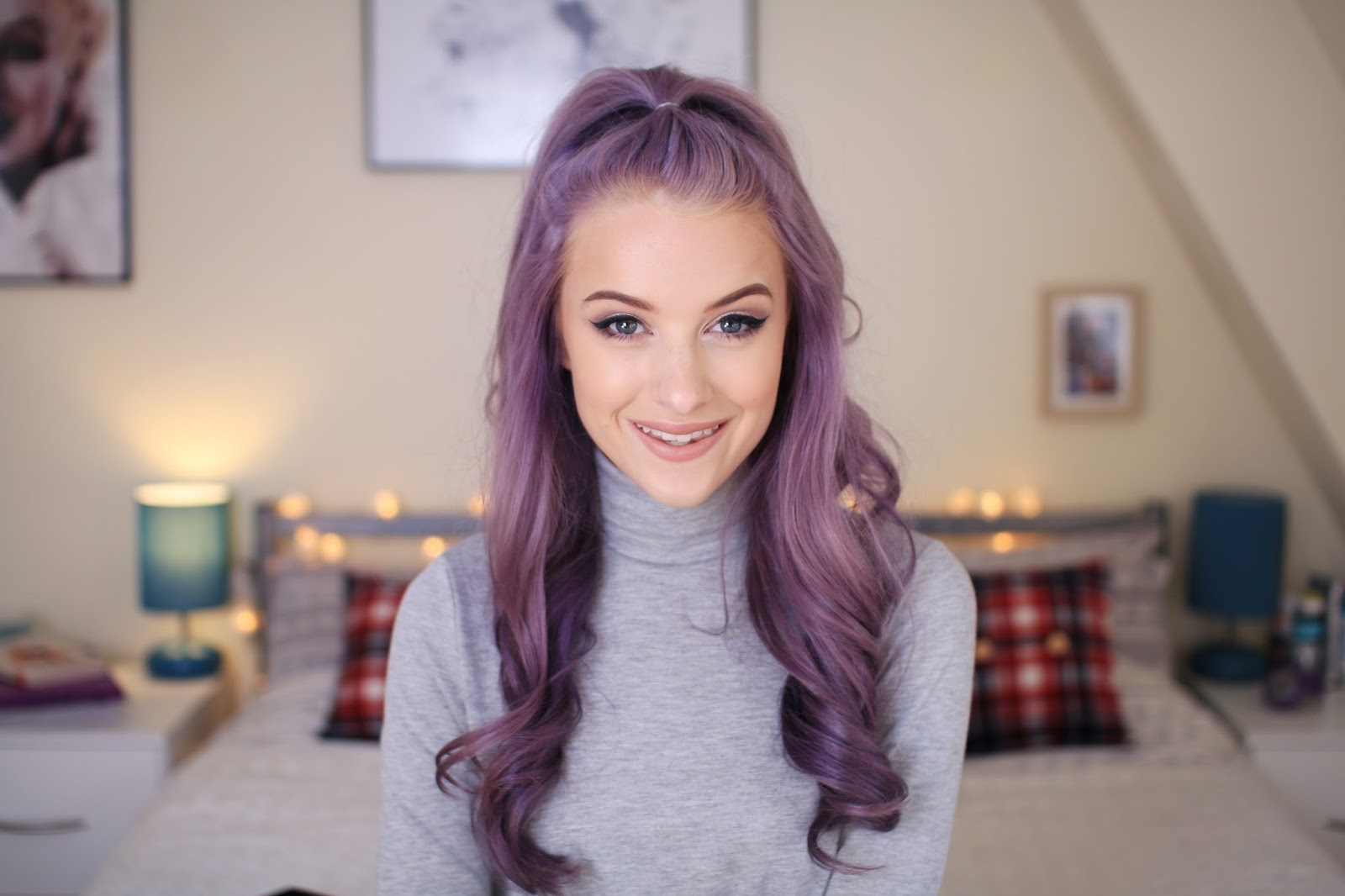 half up half down hairstyle with purple curls