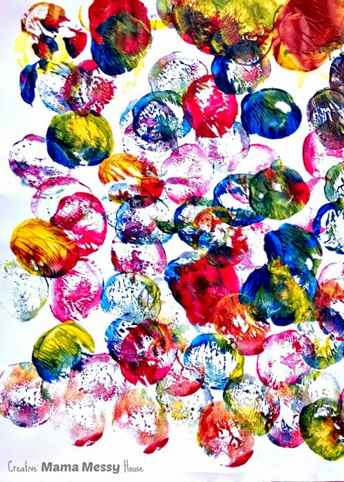 Stamping with Potatoes using primary colored paints create beautiful rainbow effects - a great project for young children!