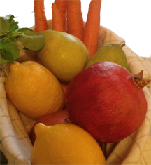 Basket of Carrots, pears, lemons, pomegranate