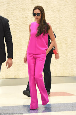 Victoria Beckham stuns in hot pink outfit at JFK airport (photos)  2C13A14B00000578-3226573-image-a-92_1441726047292