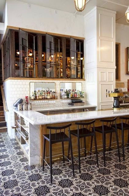 cool bar area patterned tile floor glass cabinets