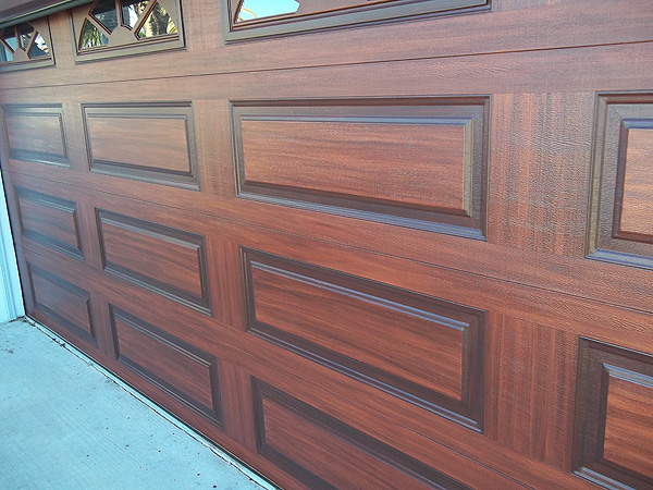 Orange base coat color on garage door everything i for Paint metal garage door to look like wood