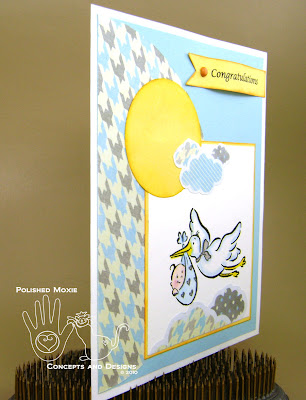 Picture of the front of the baby card set at an angle to the right to show dimension of the elements on it.