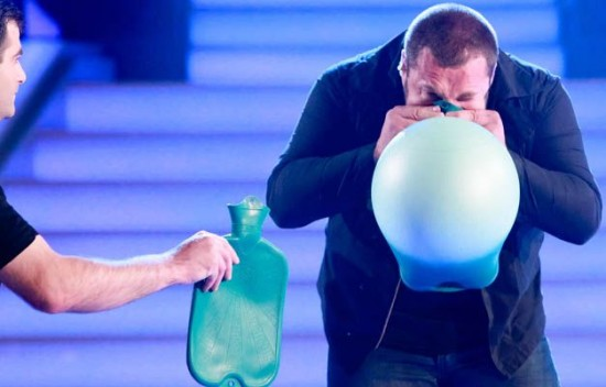 Real-Life Superhuman Blows Up Hot Water Bottles with His Nose