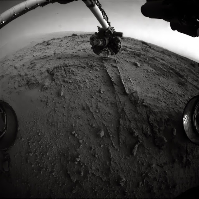 NASA's Mars rover Curiosity used a new technique, with added autonomy for the rover, in placement of the tool-bearing turret on its robotic arm during the 399th Martian day, or sol, of the mission. Image Credit: NASA/JPL-Caltech