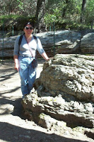 Debbie with petrified wood stumps