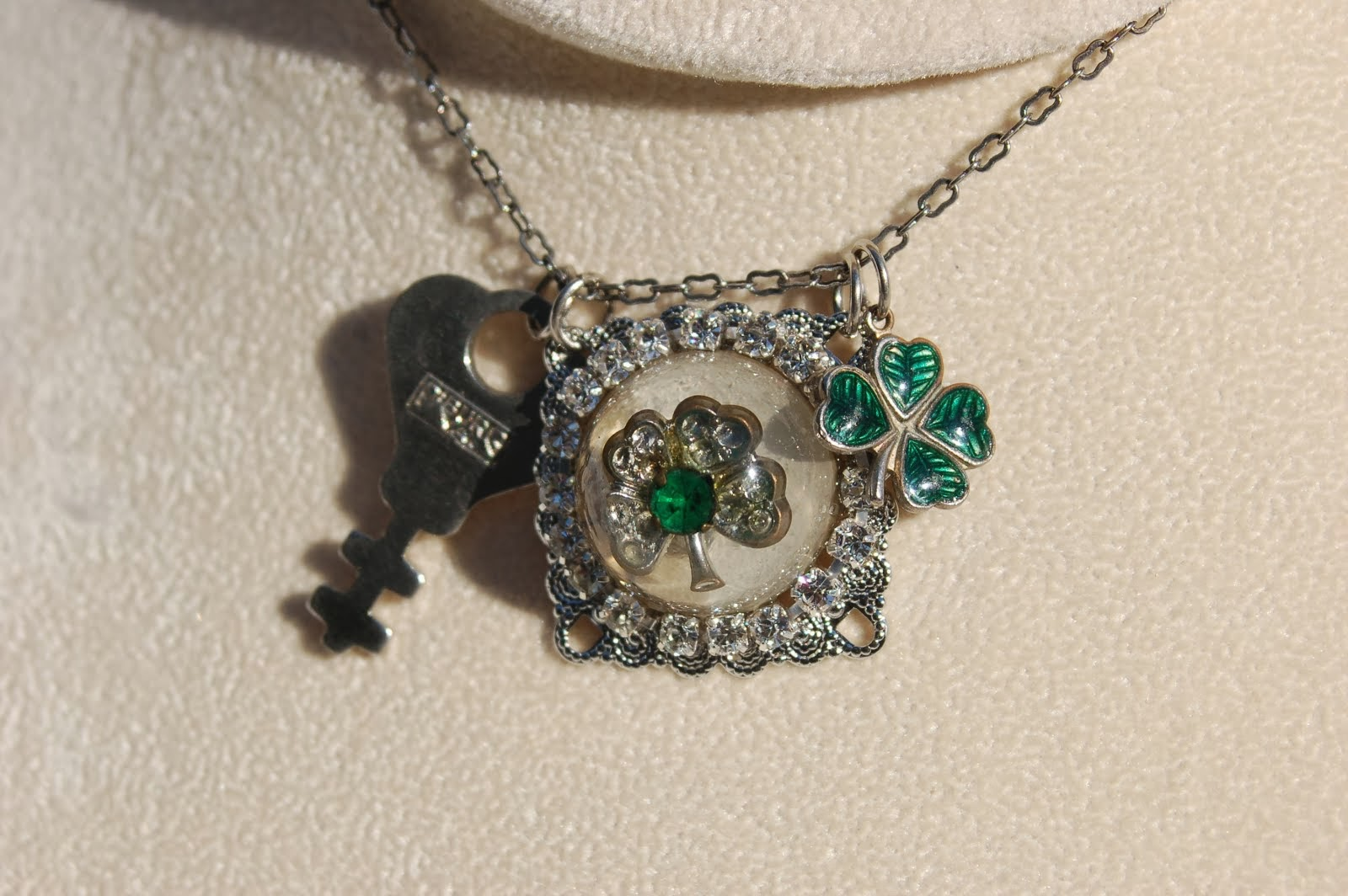 Necklace with clover earring cast in resin