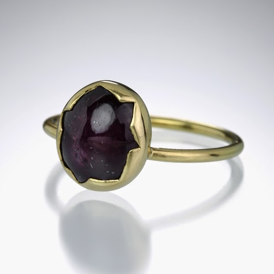http://quadrumgallery.com/jewelry/product/ruby-star-sapphire-egg-ring