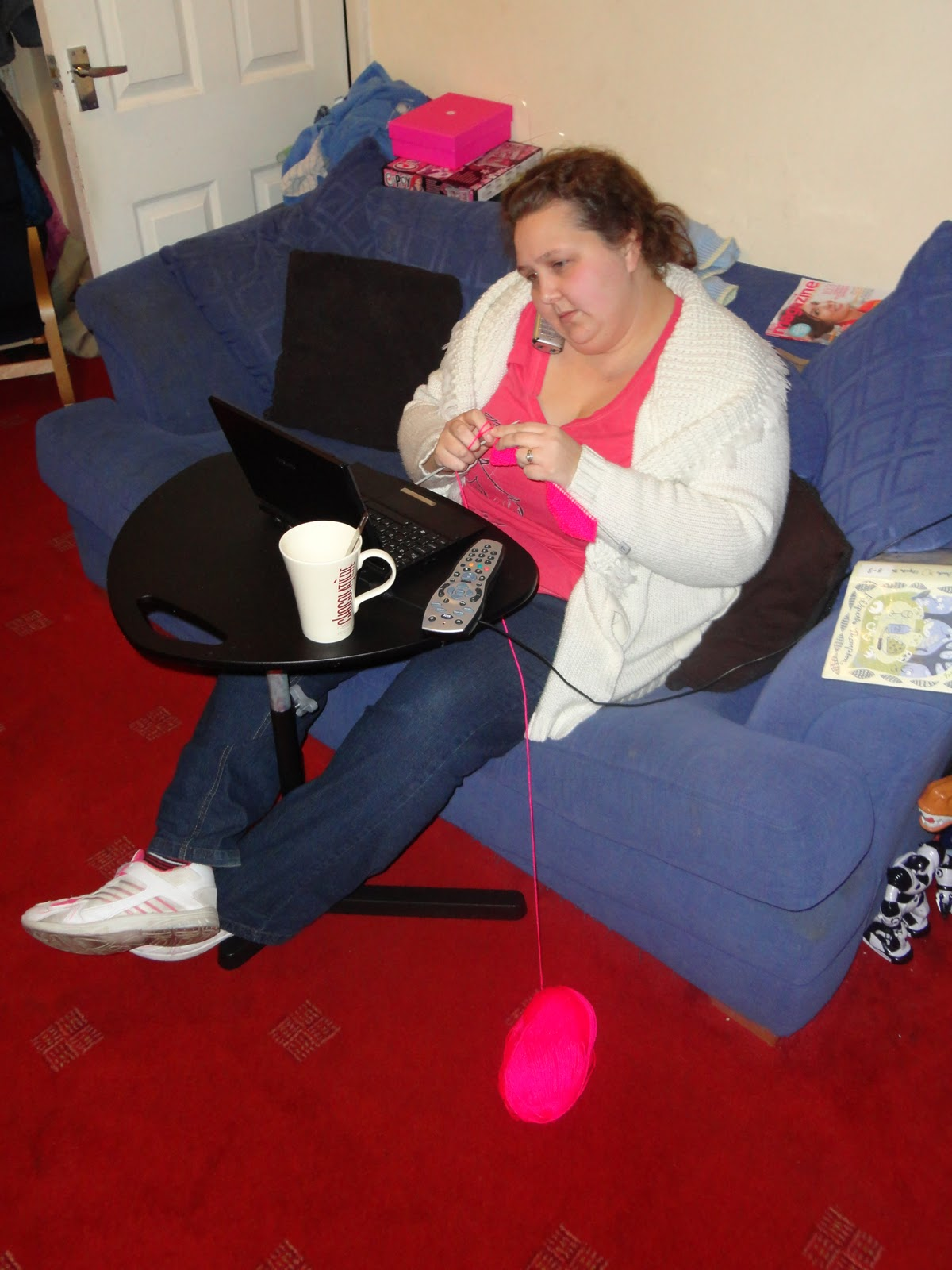 PippaD back in 2012, knitting, on the phone, drinking, on the laptop and reading...