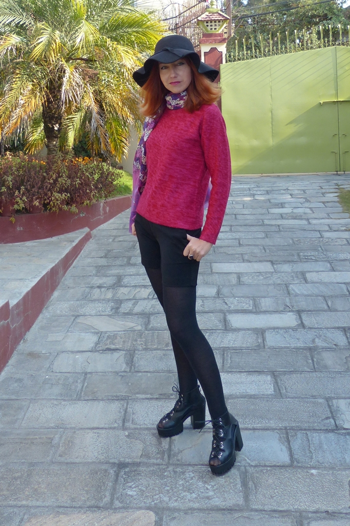 Black shorts over opaque black tights with chunky shoes, maroon sweater, cat theme scarf and hat