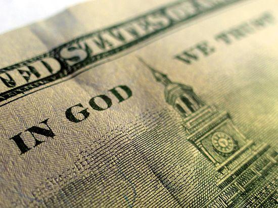 Американцы не хотят уповать на Бога: дизайн доллара может измениться
