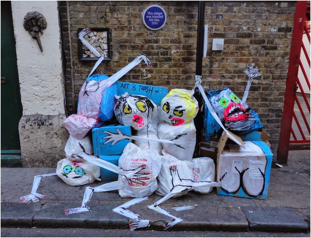 Rubbish bags and boxes turned into human like figures with faces and limbs