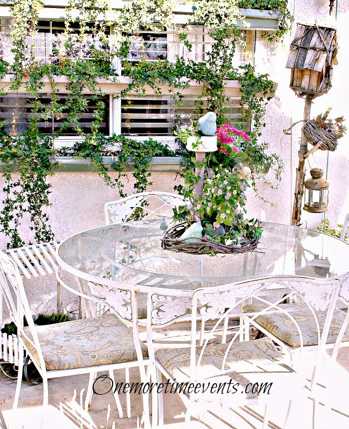 Spring patio setting with spring flowers at One More Time Evnets.com