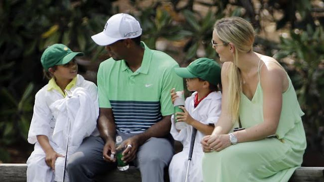 Lindsey Vonn sits with Tiger Woods and his children Sam and Charlie during the Par 3 contest at the Masters in 2015.Source:AP