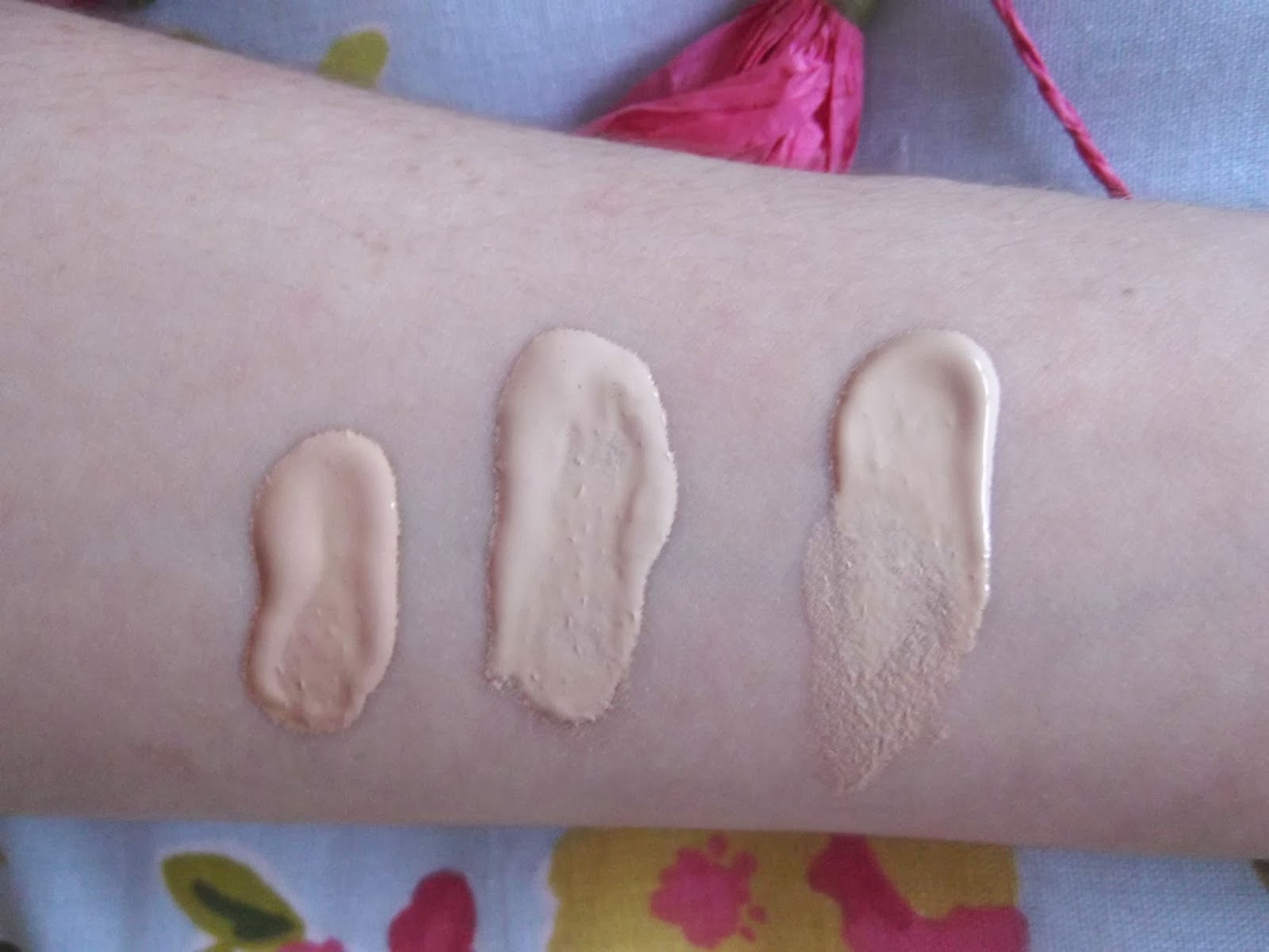 An image of Liz Earle Signature Foundation in Porcelain Swatch, Bourjois Healthy Mix Foundation in Light Vanilla Swatch and Gosh Illuminating CC Cream in Porcelain Swatch