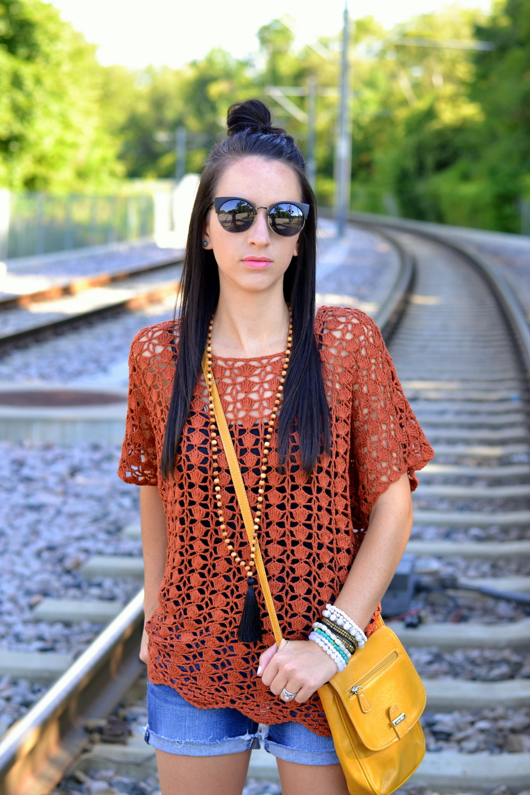 Casual summer look with Cat eyed sunglasses, crochet top and tassel necklace