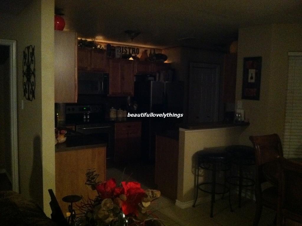 Dark Kitchen At Night beautifullovelythings: above kitchen cabinet decor