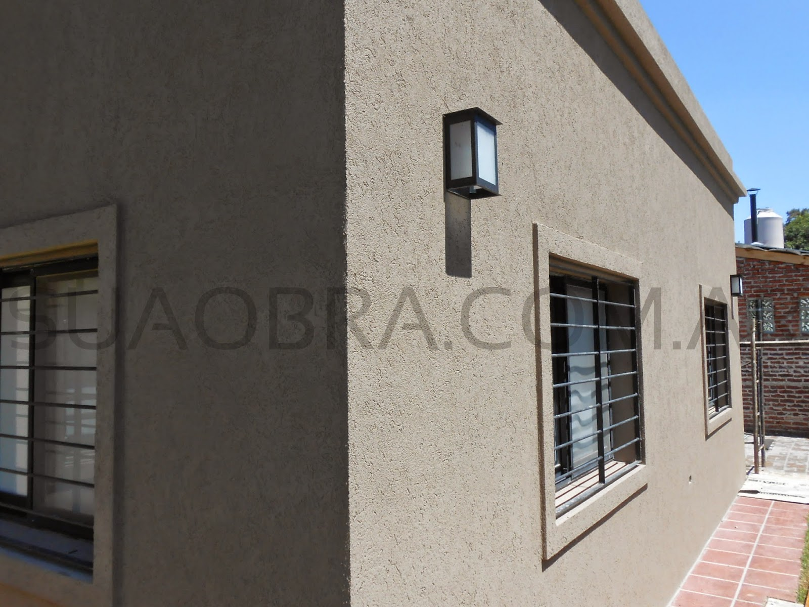 Aplicacion de revestimiento plastico para paredes - Revestimiento de fachadas exteriores ...