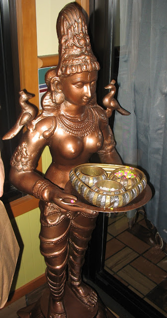 Indian Statuette offering candy